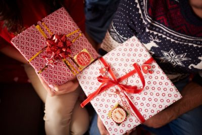Couple holding Christmas Presents