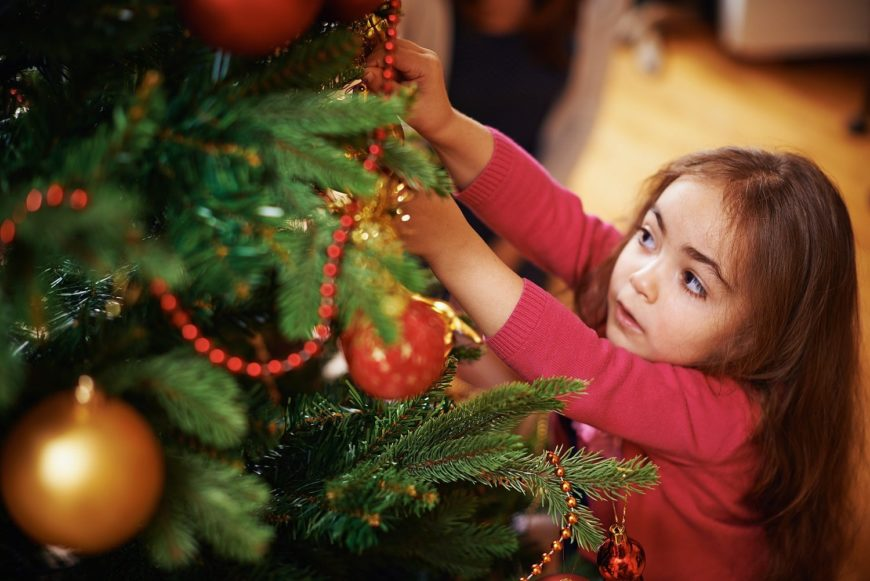Girl Preparing Christmas Tree